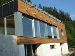 Lesena fasada Mozjanca - sibirski macesen - kombinacija treh fasad- les-plocevina-demit